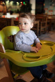 Toddler in high chair Stock Images
