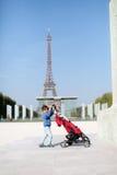 Toddler with his pram Royalty Free Stock Photo