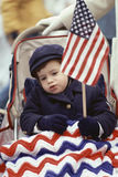 Toddler holding American flag Stock Photo