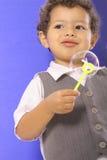 Toddler holding a bubble Stock Photos
