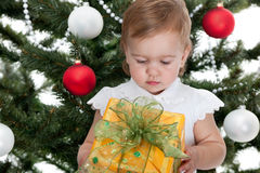 Toddler holding a christmas presen Royalty Free Stock Images