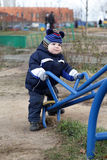 Toddler holding handle of seesaw Stock Photography