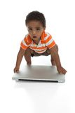 Toddler holding laptop, isolated on white background Royalty Free Stock Image