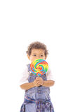 Toddler holding a lollipop Stock Photography