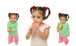 Toddler holding a lollipop wit Royalty Free Stock Photos