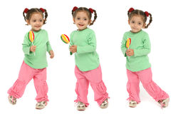Toddler holding a lollipop wit Royalty Free Stock Image