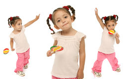 Toddler holding a lollipop wit. Little girl holding a lollipop with different expressions and emotions stock image