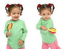 Toddler holding a lollipop wit Royalty Free Stock Photo