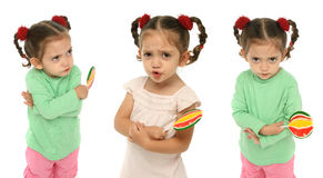 Toddler holding a lollipop wit Royalty Free Stock Photography