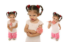 Toddler holding a lollypop wit. Little girl holding a lollypop with different expressions and emotions Royalty Free Stock Photography