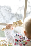 Toddler Holding a Paint Brush Stock Photography