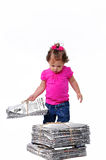 Toddler holding a stack of paper ready for recycli stock image