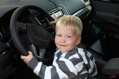 Toddler holding the steering wheel playing to be driver Royalty Free Stock Photo