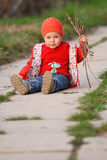 Toddler holding sticks Stock Photos