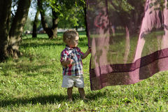 Toddler holding tulle Royalty Free Stock Photography