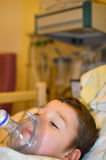 Toddler in hospital with an oxygen mask Stock Photo