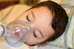 Toddler in hospital with an oxygen mask Royalty Free Stock Photos