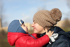 Toddler hugging mother. Toddler hugging his mother at the park in autumn Royalty Free Stock Image