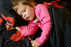 Toddler is ill. Toddler girl  is ill and she is laying in the bed Royalty Free Stock Photo
