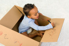 Toddler In A Box Stock Photo