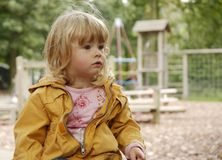Toddler interested 2. A small girl on a playground interested in what is going on Stock Photos