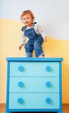 Toddler jumping from furniture Royalty Free Stock Photography
