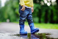 Toddler jumping in pool of water Royalty Free Stock Image