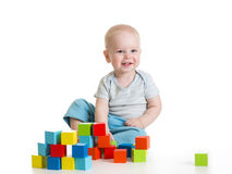 Toddler kid boy playing wooden toys royalty free stock image