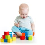 Toddler kid boy playing  wooden toys Stock Photos