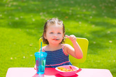 Toddler kid girl eating macaroni tomato pasta Royalty Free Stock Photos
