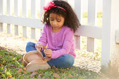 Toddler kid girl portrait in a park fence Royalty Free Stock Photo