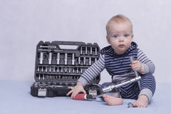 Toddler kid playing with set of instruments. Illustration for building sphere. An infant boy with tool box and stock photos