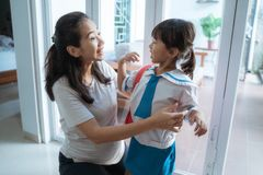 Toddler Kid Preparing For School In The Morning With Mom Stock Images