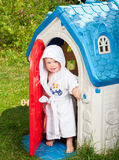 Toddler in kids playhouse outdoor Royalty Free Stock Image