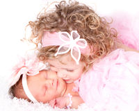 Toddler kissing her baby sister Royalty Free Stock Images
