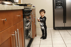 Toddler in kitchen Royalty Free Stock Photos