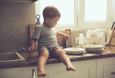 Toddler in the kitchen alone Royalty Free Stock Photography