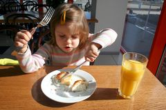 Toddler with knife and fork Stock Images