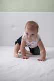 Toddler laugh baby on bed, first teeth Stock Photos