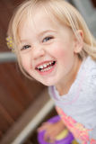 Toddler laughing. Little toddler laughing at the camera stock photography