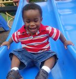 Toddler laughing on slide