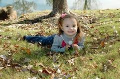 Toddler in Leaf's Stock Image