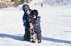 Toddler Learning to Ski at Dressed Safely Stock Image