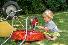 Toddler learning to use ratchet tool. Royalty Free Stock Photo