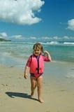 Toddler in life jacket stock image
