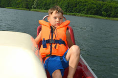 Toddler with life jacket moves pedal Royalty Free Stock Image