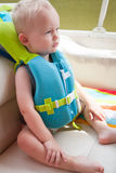 Toddler in Life Vest. A child wearing a life jacket for safety on a boat on a lake royalty free stock images