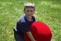 Toddler Lifting Ball royalty free stock photos