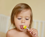 Toddler with lollipop Stock Images