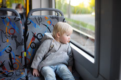 Toddler looking out train or tram window Royalty Free Stock Photography